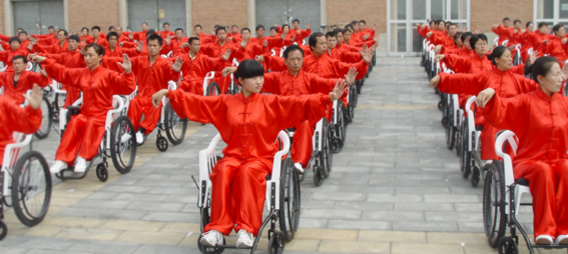 Wheelchair Tai Ji participants prepare for the demonstration at the Opening Ceremony of 2007 Beijing Olympics Cutlrual Festivial (China National Training Center, Beijing 2007)