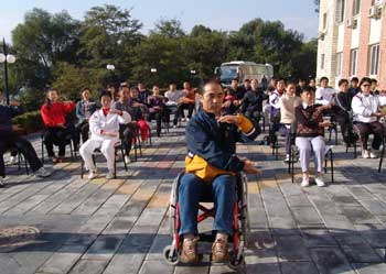 Dr.Guo instructs participants at the First National Wheelchair Tai Ji Quan instructors' Workshop in Beijing 2006
